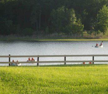 guest on pedal boats in lake, florida spiritual retreat venue